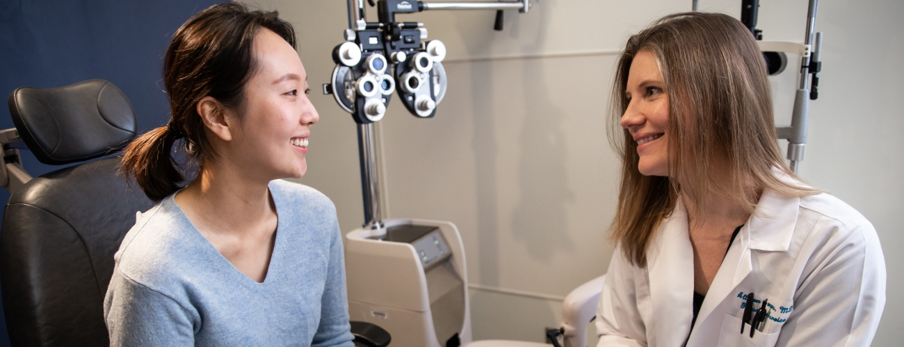 eye specialist consulting with a patient